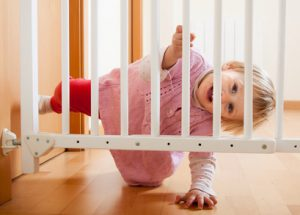 Small baby approaching safety gate of  stairs Graves and Richard, Personal Injury Lawyer Office, St. Catharines, Ontario